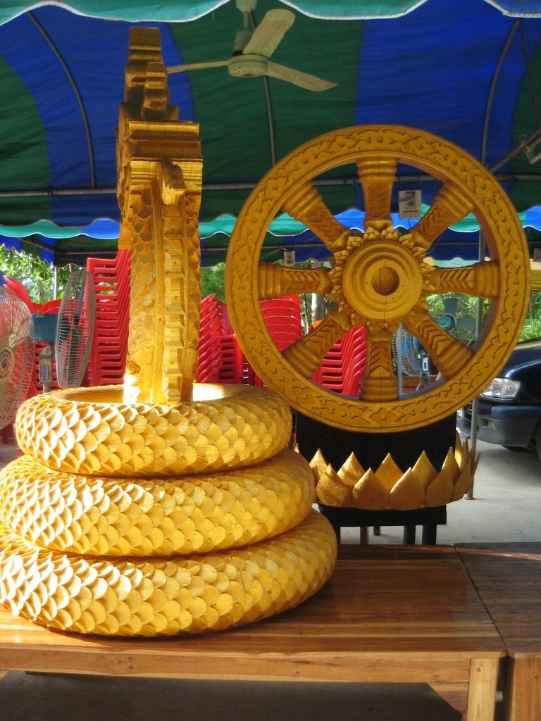 dhamma wheel and naga statue