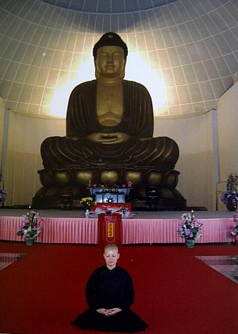 Paying respects to Buddha at Kong Meng San at Birshan