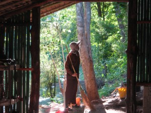 Taken in May 2009- Khun Mae was constructing the Cave temple and was in deep though as the late afternoon sun shone on her.