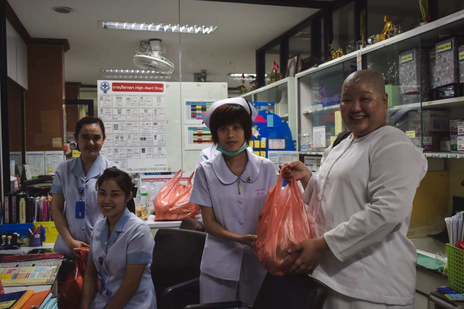 Passing donations and useful daily items to hospital staff