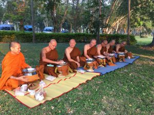 The monks having lunch using their almsbowl