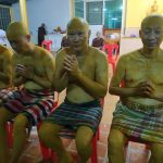 Bathing in turmeric before monks ordination